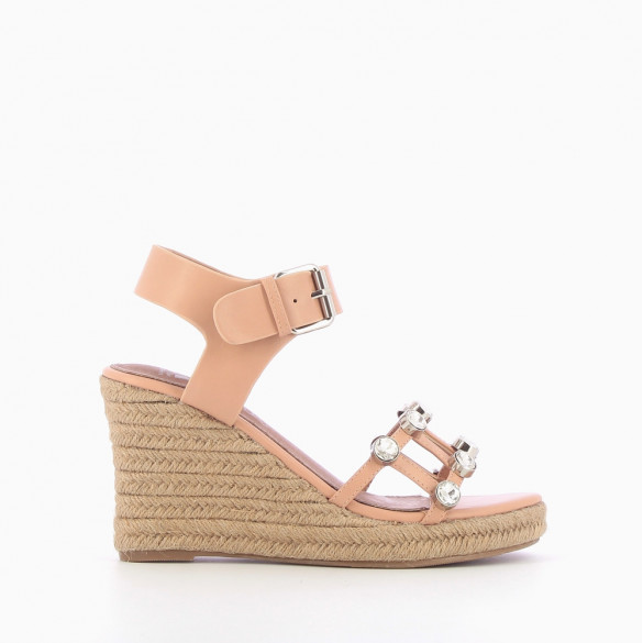 Pink wedge sandals adorned with costume jewels