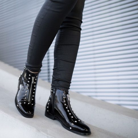 Black patent leather boots with conical studs