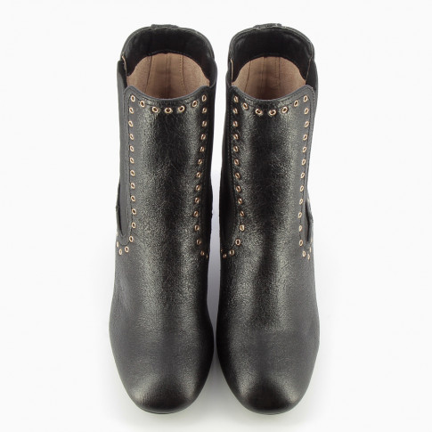 Black Chelsea boots with gold eyelets