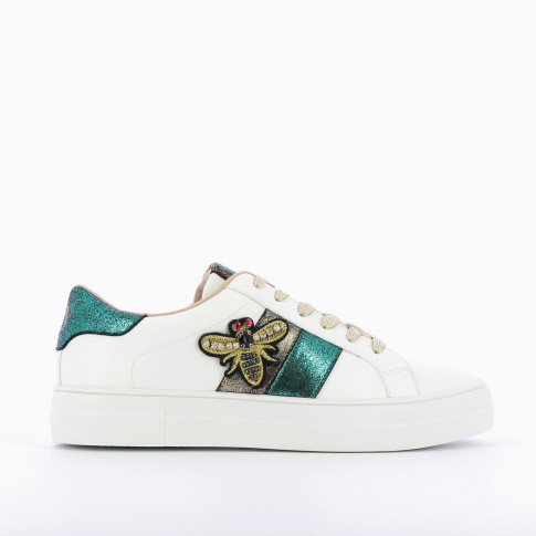 White and green sneakers with bee-shaped jewelry