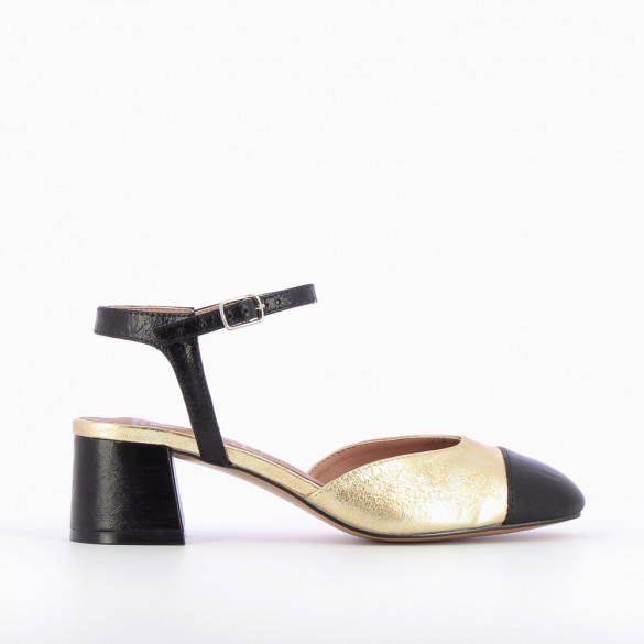 Gold sandals with textured black toe cap