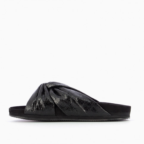 Black mules with bowed straps