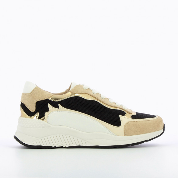 Beige and black sneakers with flame cutouts