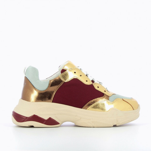 Plum and gold sneakers with large sole