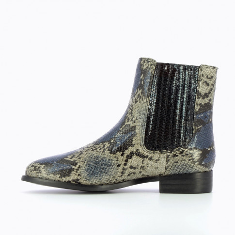 Gray and blue Chelsea boots with black elastic