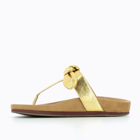 Gold flip-flops with decorative bow