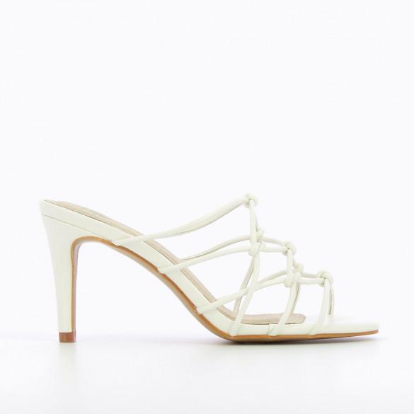 White mules with bowed straps