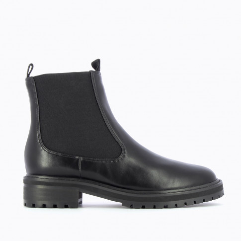 Black Chelsea boots with serrated sole