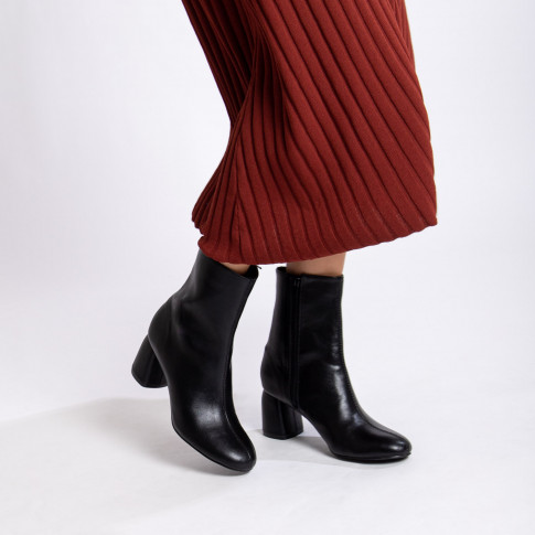 Black ankle boots with curved heel