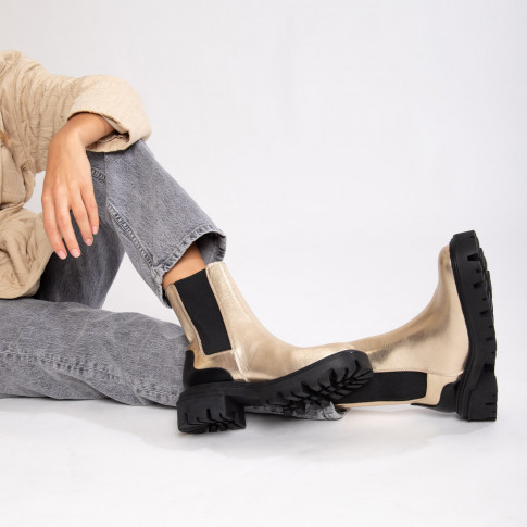 Gold Chelsea ankle boots with black heel notch