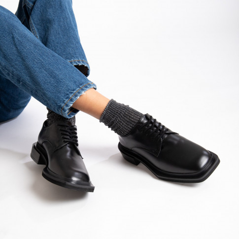 Black brogues with square sole